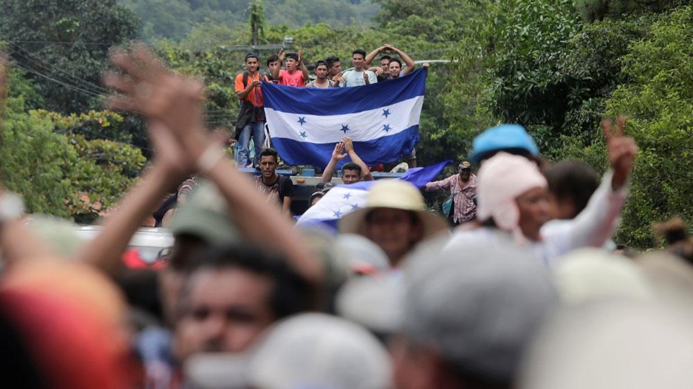 migrants marching towards us border