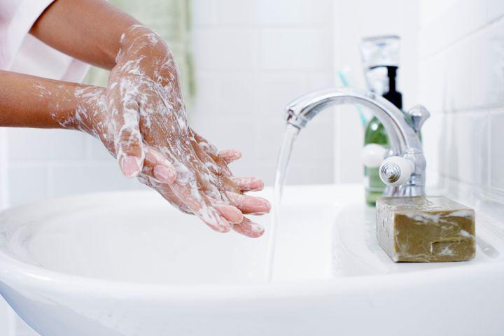 soap or sanitizer, wash hands with soap and water to disinfect them