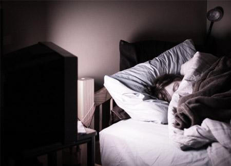 sleeping in television light