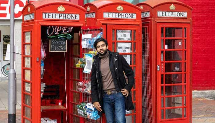 Pakistani entrepreneur in UK phone booth